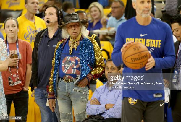 Super fan Jimmy Goldstein center watches the Golden State Warriors warm up before Game 2 of the NBA Finals against the Cleveland Cavaliers at Oracle...