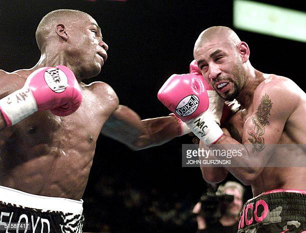 Super Featherweight Champion Floyd Mayweather of Grand Rapids MI hits Diego Corrales of Sacramento CA with a left to the head in the seventh round...