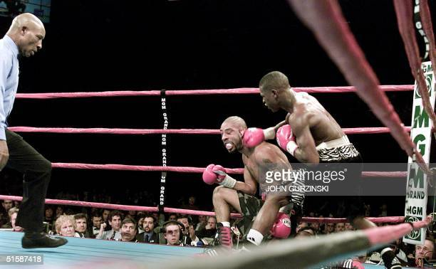 Super Featherweight Champion Floyd Mayweather of Grand Rapids MI pounds Diego Corrales of Sacramento CA to the mat for the fourth knockdown during...