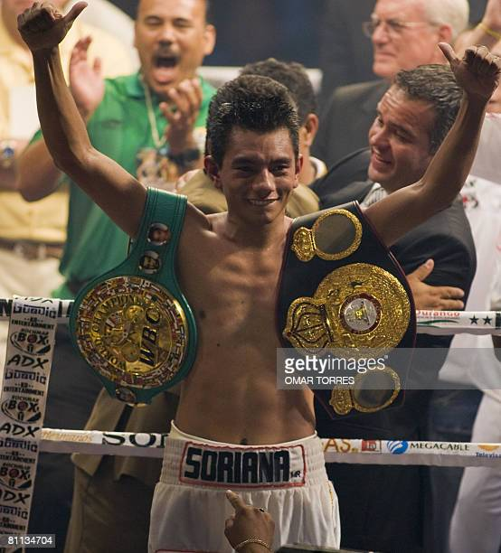 WBC Super Flyweight Champion Mexican Cristian Mijares celebrates after defeated the WBA Super Flyweight Champion Alxander Munoz of Venezuela during...