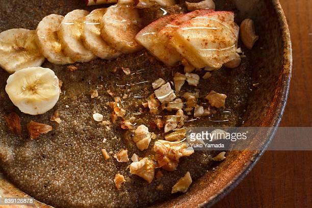 Super Food - Morning Breakfast Teff Porridge Nuts and Fruits on Top