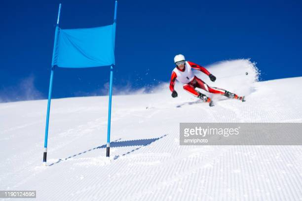 super g race, skier blurred, focus on flag - ski racing stock pictures, royalty-free photos & images