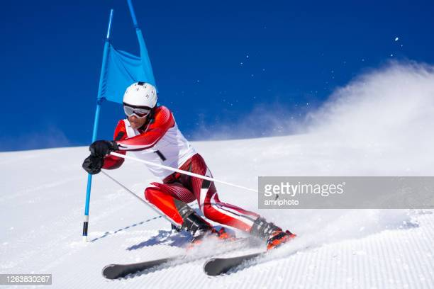 super g skiing training on ski slope - downhill skiing stock pictures, royalty-free photos & images
