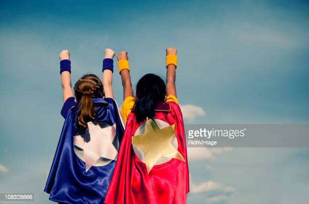super girl duo - superhero stock pictures, royalty-free photos & images