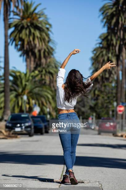 Super happy woman walking down the street in Los Angeles