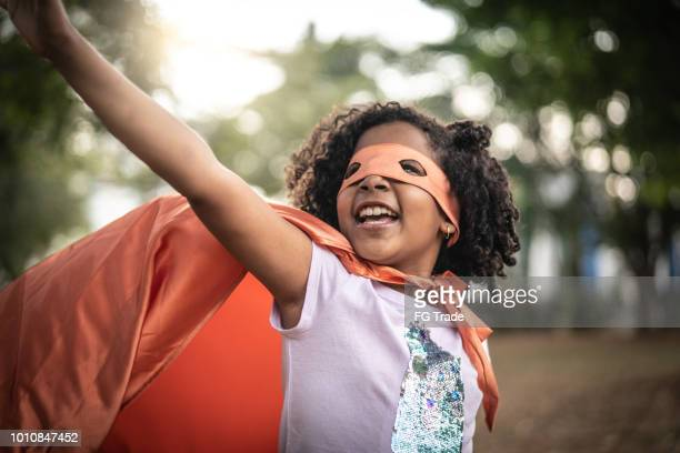 super hero little cute girl - budding tween stock photos and pictures