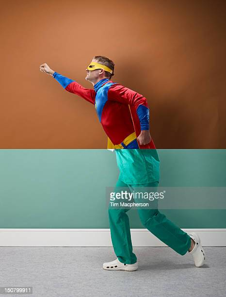 super hero top, surgeon bottom - superhero stock pictures, royalty-free photos & images