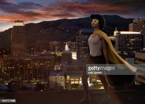 super hero woman standing above salt lake city - salt lake city utah stock photos and pictures