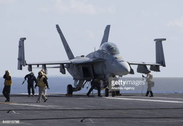 Super Hornet and F/A18 Hornet warplanes are seen on the flight deck of US aircraft carrier USS George Washington during its mission in the eastern...
