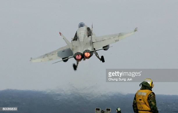 Super Hornet strike fighter takes off from the deck of USS Aircraft Carrier Nimitz during an exercise at sea on March 3 2008 off the coast of South...