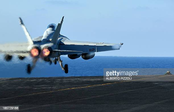 Super Hornet takesoff from the US navy's supercarrier USS Nimitz in the Mediterranean Sea on October 24 2013 The US aircraft carrier is on standby in...