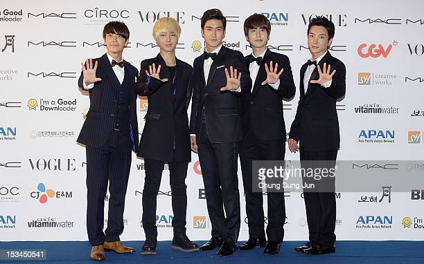 Super Junior arrives for APAN Star Road during the 17th Busan International Film Festival at the Haeundae beach on October 5, 2012 in Busan, South...