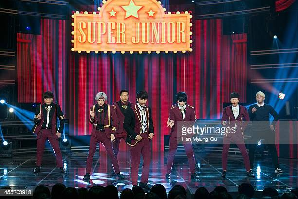 """Super Junior perform on stage during the MBC Music """"Show Champion"""" on September 10, 2014 in Ilsan, South Korea."""