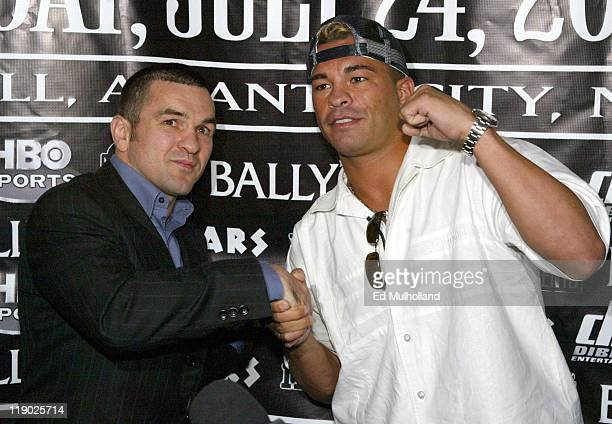 WBC Super Lightweight Champion Arturo Gatti and challenger Leonard Dorin pose at JayZ's 40/40 Club during the announcement of their upcoming fight...