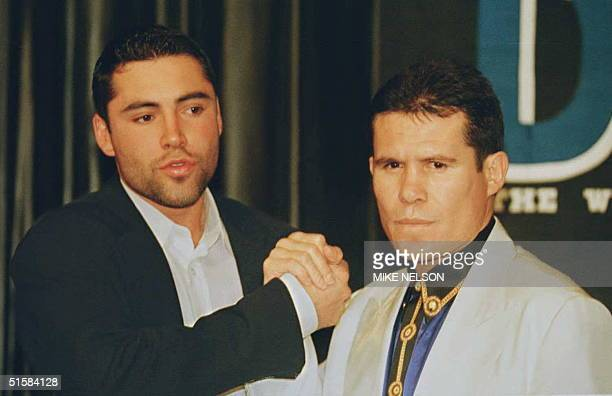 Super Lightweight Champion Julio Cesar Chavez from Mexico clasps hands with WBO Lightwieght Champion Oscar de la Hoya from Los Angeles following a...