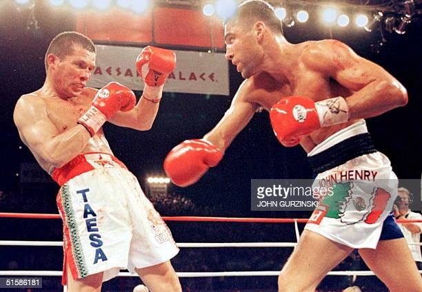 Super Lightweight Champion Julio Cesar Chavez from Mexico reels from a left by challenger Oscar de la Hoya from the US in the 4th round at Caesars...