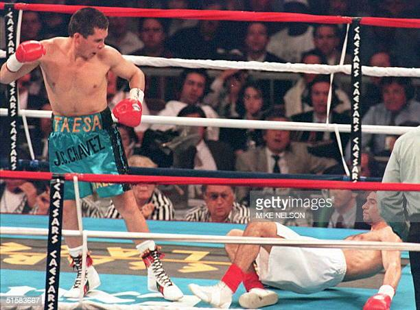WBC super lightweight champion Julio Cesar Chavez of Mexico looks at challenger Giovanni Parisi of Italy after he knocked him down in the second...