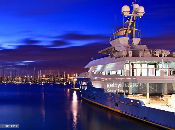 super luxury yatch moored on auckland harbour with marina in background - luxury yacht stock pictures, royalty-free photos & images