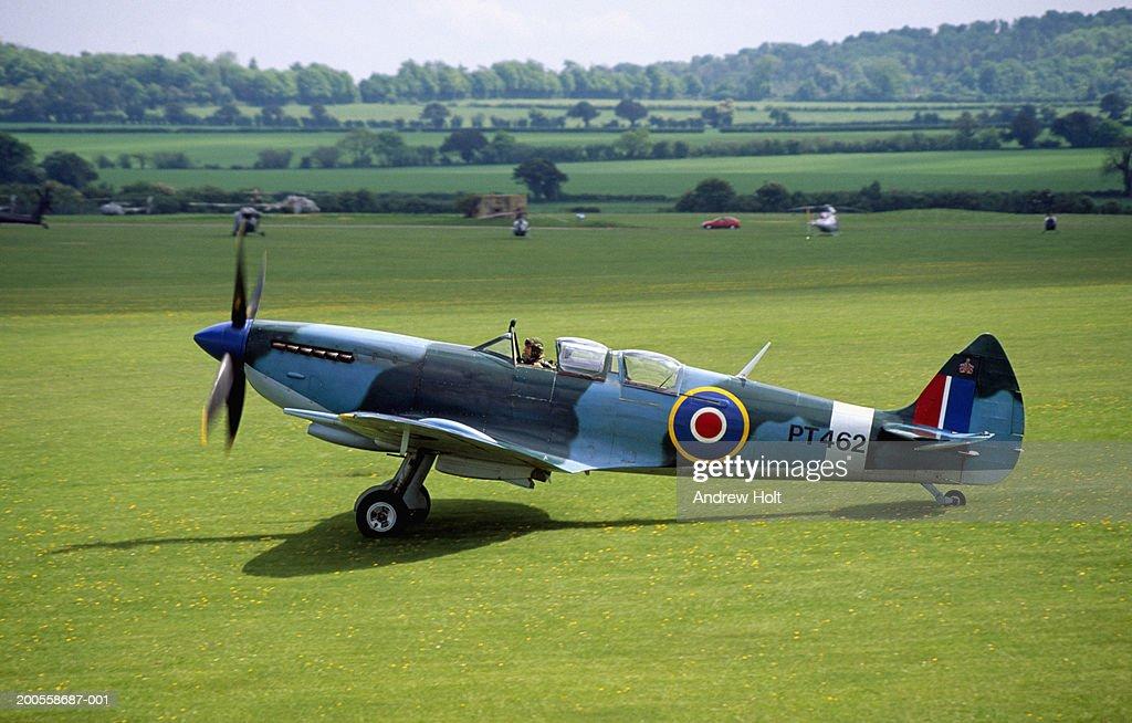 Super marine Spitfire aircraft on grass airfield : Stock Photo
