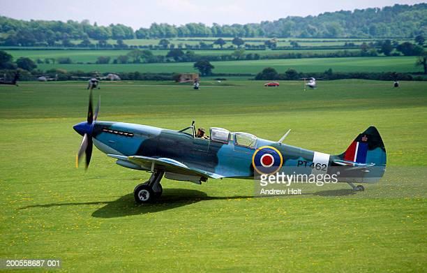 Super marine Spitfire aircraft on grass airfield