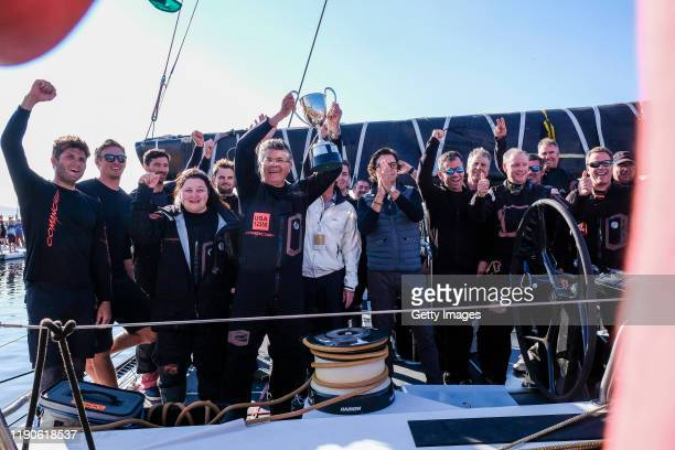 Super Maxi Comanche at Constitution Dock with Skipper Jim Cooney and coowner Samantha Grant and crew celebrating after winning the 2019 Sydney to...