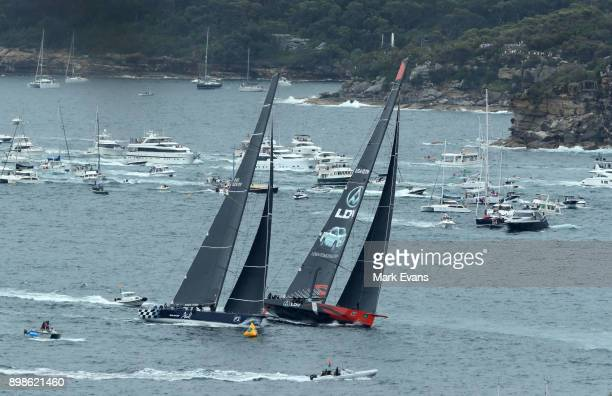 Super Maxis BlackJack and Commanche round the first mark after the start of the Sydney to Hobart Yacht Race on Sydney Harbour during the 2017 Sydney...