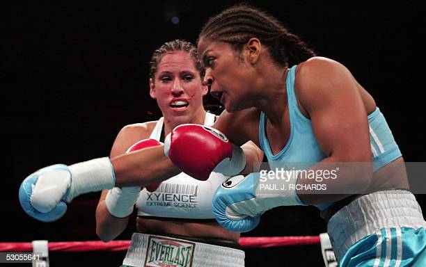 Super Middleweight Champion Laila Ali unleashes a right against Erin Toughill in the second round 11 June 2005 at the MCI Center in Washington DC Ali...