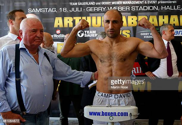 Super middleweight fighter Arthur Abraham of Germany poses during the weigh in at the Orth Nagel Autohaus on July 17 2015 in Halle Germany