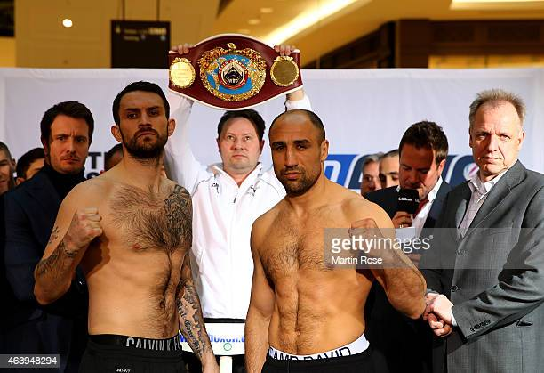 Super middleweight fighter Paul Smith of Great Britain and Arthur Abraham of Germany pose during the weigh in at the mall of Berlin on February 20...