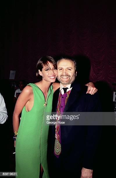 Super model Christy Turlington gives Italian designer and toast of Paris Miami and New York Gianni Versace a hug at a 1991 Los Angeles California...