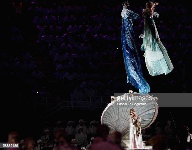 Super Model Eva Herzigova is shown in a clam shell during a theatrical representation of Botticelli's Birth of Venus at the Opening Ceremony of the...
