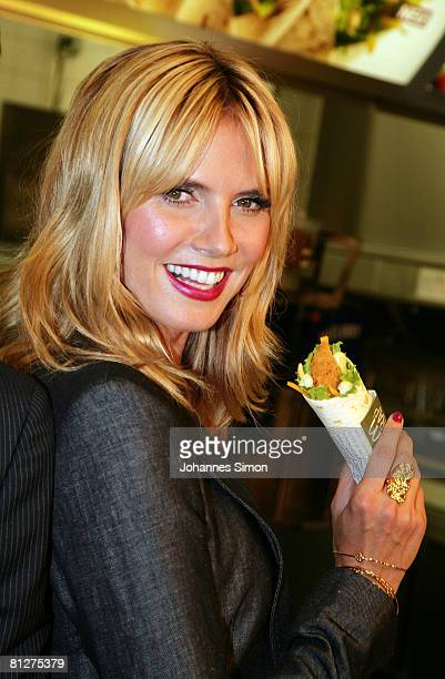 Super model Heidi Klum poses with a new designed McDonald's chicken wrap during a press conference at the Munich Inner City McDonald's Restaurant 'Im...