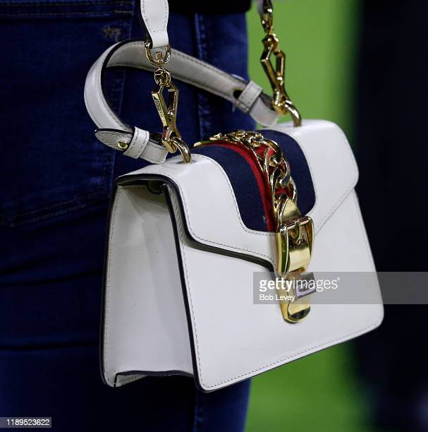 Super model Kate Upton dons a Gucci purse as she and her husand Justin Verlander take in pregame activities at NRG Stadium on November 21 2019 in...