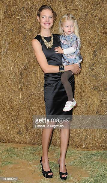 Super Model Natalia Vodionova poses with her daughter Neva during the Chanel Pret a Porter show as part of the Paris Womenswear Fashion Week...