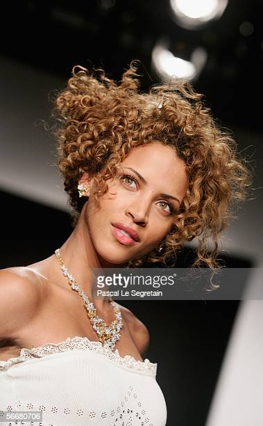 Super Model Noemie Lenoir wears a Chopard jewelry and a creation as part of the last collection of the 'New Haute Couture' during the Paris Fashion...