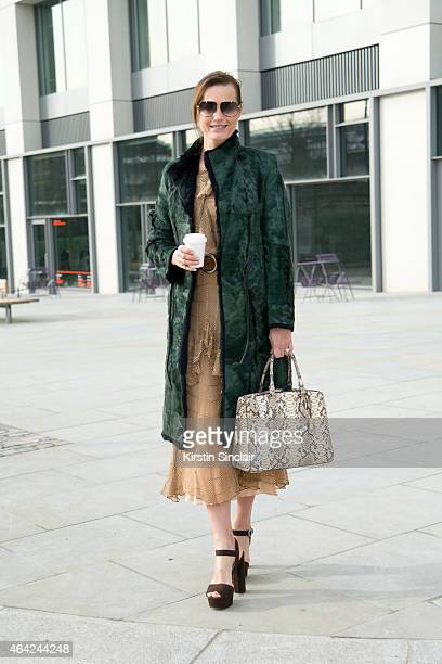 Super Model Yasmin Le Bon wears a vintage dress Gucci jacket Prada shoes Michael Kors bag and Tom Ford sunglasses on day 3 of London Collections...