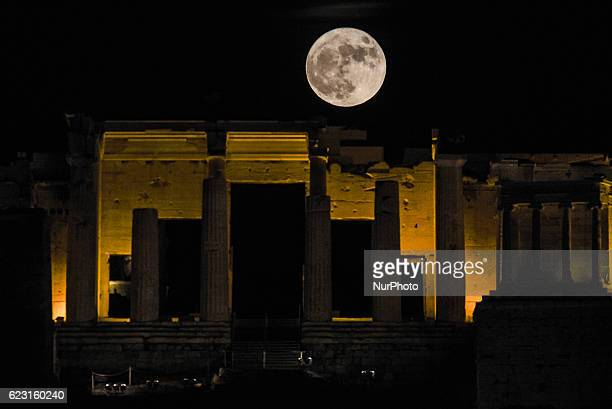 Super moon of November 2016 at the closest distance to earth since about 70 years as seen from Filopappou hill with view to the Acropolis of Athens...