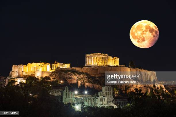 super moon over the acropolis in athens, greece - supermoon stock pictures, royalty-free photos & images