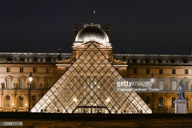 Super moon rises over the closed Louvre Museum and Louvre Pyramid as the lockdown continues due to the coronavirus outbreak on May 07, 2020 in Paris,...