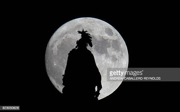A super moon rises over the Statue of Freedom on the Capitol dome in Washington DC November 13 2016 The supermoon will venture to its closest point...