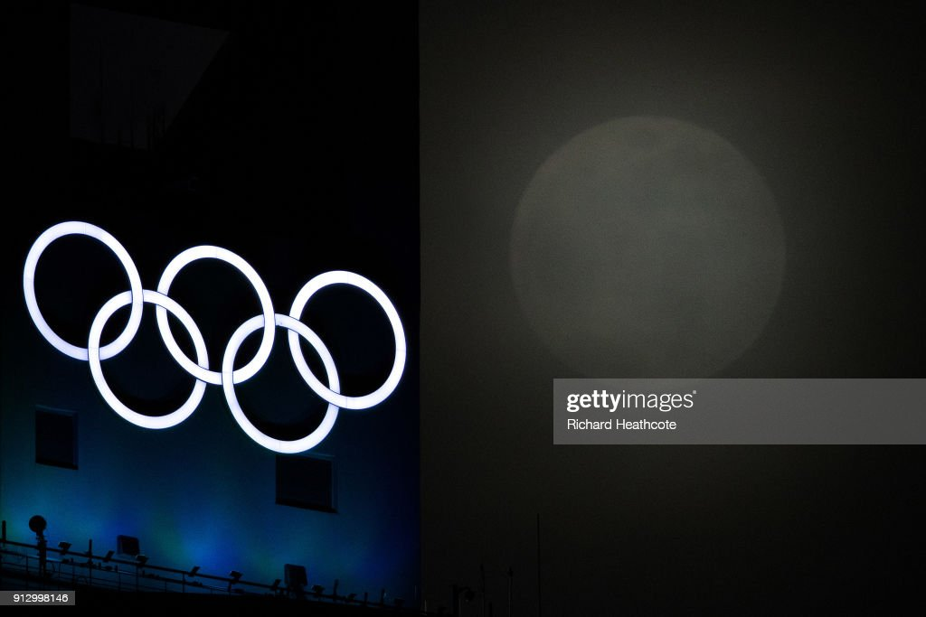 Super Moon rises through the clouds past the Olympic Rings ahead of the Pyeongchang 2018 Winter Olympics on January 31, 2018 in Pyeongchang-gun, South Korea.