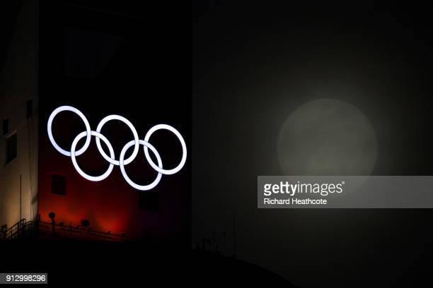 Super Moon rises through the clouds past the Olympic Rings ahead of the Pyeongchang 2018 Winter Olympics on January 31 2018 in Pyeongchanggun South...