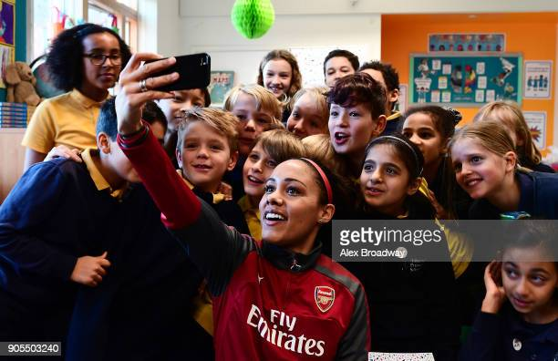 Super Movers ambassador Alex Scott takes a selfie during a classroom session during the Premier League and BBC Super Movers launch event at Ashmount...