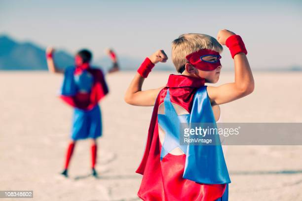 super muscles - cape garment stock photos and pictures