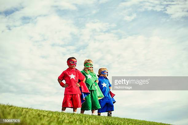super preschoolers - three people stock pictures, royalty-free photos & images