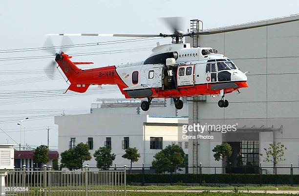 Super Puma AS332 L2 helicopter from the Hong Kong Government Flying Service arrives at the Shanghai Gaodong Airport on July 4, 2005 in Shanghai,...