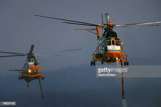 Super S-61 Firefighting helicopters, flown by Carson Helicopter Services, fill up with water from Big Bear Lake while fighting the Butler 2 Fire...