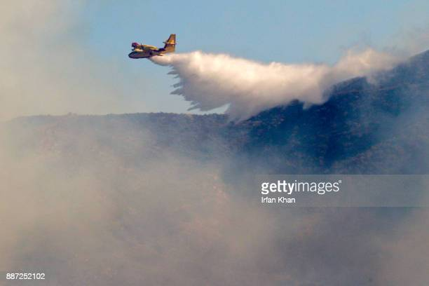 A super scooper drops water on Creek Fire burning along Little Tujunga in National Forest