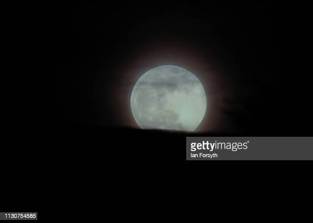 Super snow moon is seen through cloudy skies over Saltburn on February 19 2019 in Saltburn By The Sea United Kingdom The super moon at this time of...