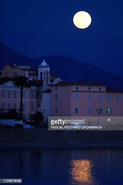 A 'Super Snow Moon' rise over Ajaccio on the French Mediterranean island of Corsica on February 19 2019 Super Moon is a term used when a full moon is...